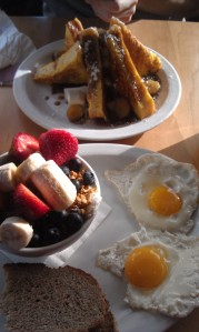 Banans Foster French Toast and Greek Yogurt topped with fresh fruit, granola, and honey + two eggs and dry toast